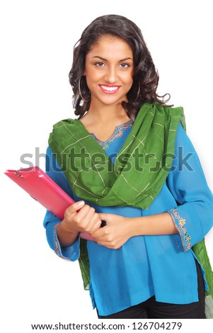 Pretty indian student with file in traditional clothes - stock photo