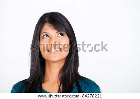 pretty indian woman looking up - stock photo