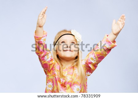Pretty inspired little girl - stock photo