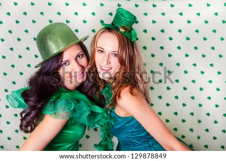 Pretty Irish women in Green and a shower of Shamrocks - stock photo