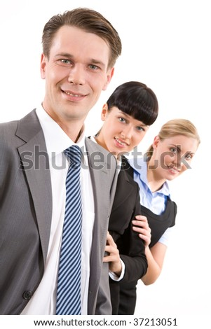 Pretty ladies looking at camera from behind confident man