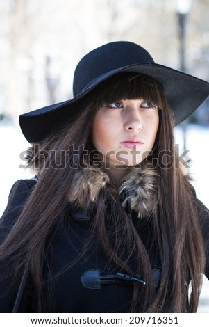 Pretty lady in coat and hat.
