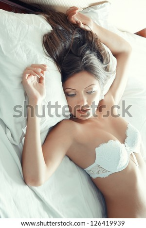 Pretty lady in lingerie laying on the bed