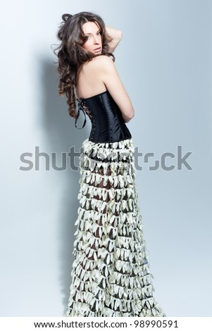 Pretty lady looking back - stock photo