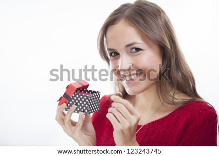 Pretty latin woman in red getting a ring as a valentine's gift - stock photo