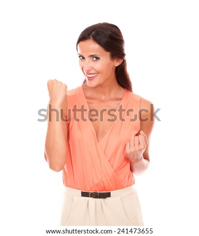 Pretty latin young lady gesturing winning while looking at you in white background - stock photo