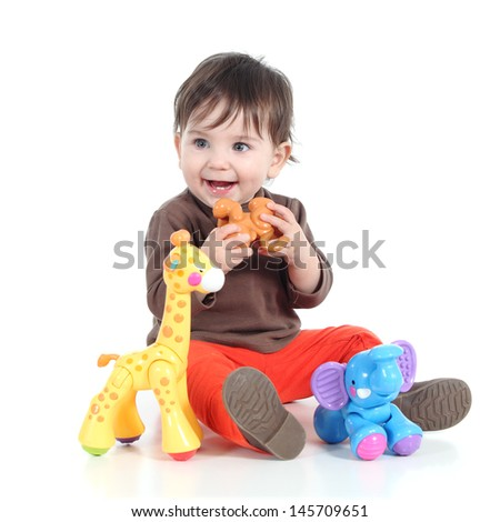 Pretty little baby girl playing with animal toys isolated on a white background          - stock photo