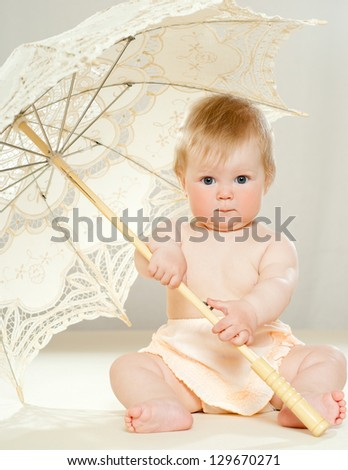 pretty little baby with a lace parasol - stock photo