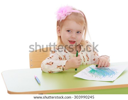 Pretty little Blonde girl sitting at the table and draws a marker On a white sheet of paper , close-up-Isolated on white background - stock photo