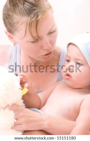 Pretty little boy with mom