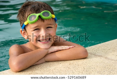 Pretty little boyl in swimming pool