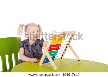 pretty little child playing with the abacus