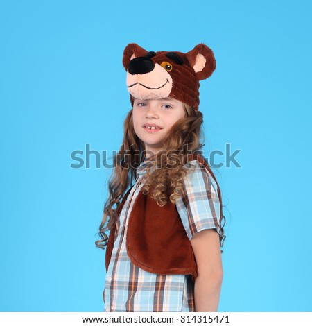 pretty little emotional child in the bear carnival costume