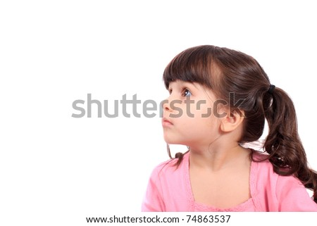 Pretty little four year old girl looking to the side and up, with copy space - stock photo