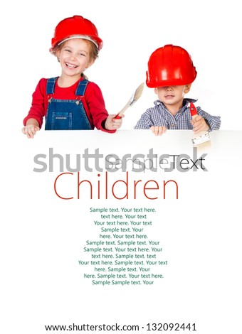 Pretty little girl and boy in halmet holding white banner with sample text - stock photo