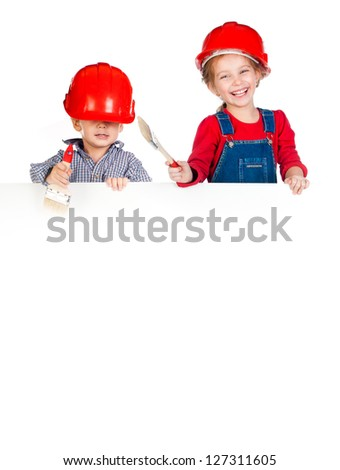Pretty little girl and boy in halmet with white banner - stock photo