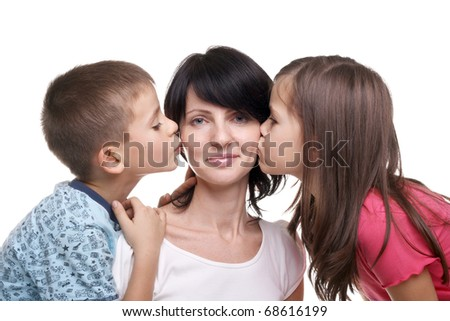 pretty little girl and boy kissing their mother - stock photo
