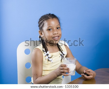 Pretty little girl at snack time - stock photo