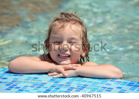 pretty little girl bathe in pool, closed eyes - stock photo