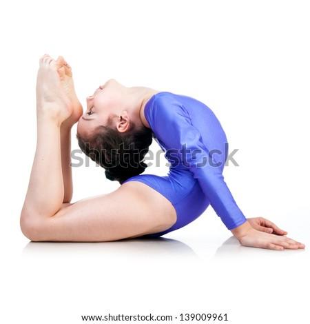 pretty little girl doing gymnastics over white - stock photo