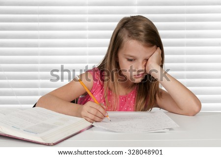 Pretty little girl doing her school homework