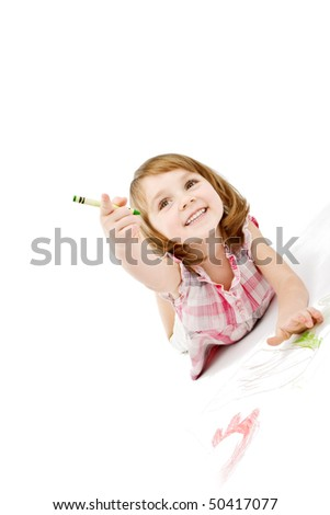 Pretty little girl drawing. - stock photo