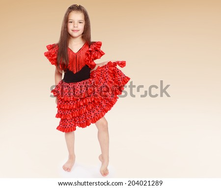 Pretty little girl dressed in a red dress.Happiness concept,happy childhood,carefree childhood - stock photo