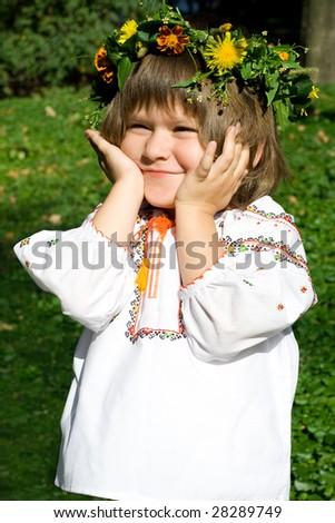 Pretty little girl dressed in Ukrainian folk costume - stock photo
