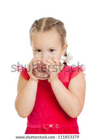 pretty little girl drinking water from glass over white background - stock photo