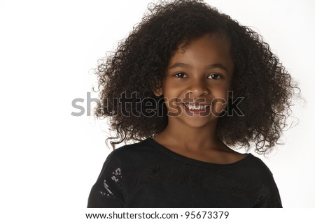 Pretty little girl.  First grader with big smile. - stock photo