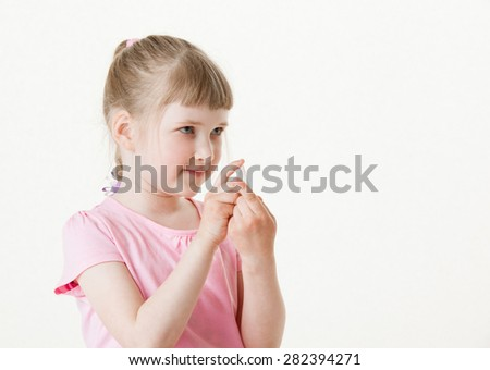 Pretty little girl holding the small card , white background - stock photo