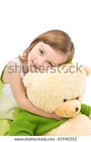 Pretty little girl hugging big bear isolated on white. - stock photo
