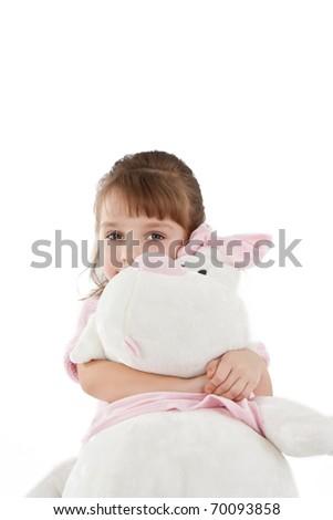 Pretty little girl hugging big white rabbit isolated on white. - stock photo