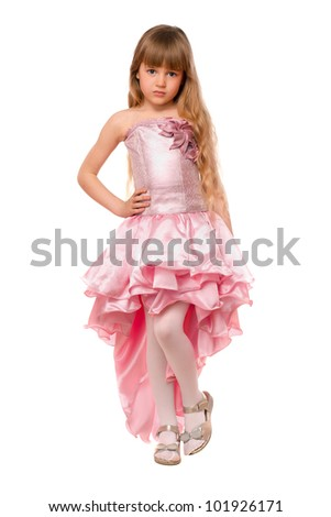 Pretty little girl in a chic pink dress. Isolated