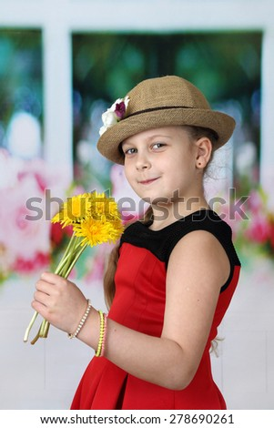 Pretty little girl in hat with dandelions in her hand - children beauty and fashion concept - stock photo