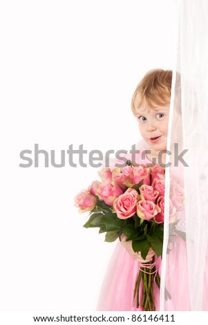 pretty little girl in pink dress with bunch of roses - stock photo