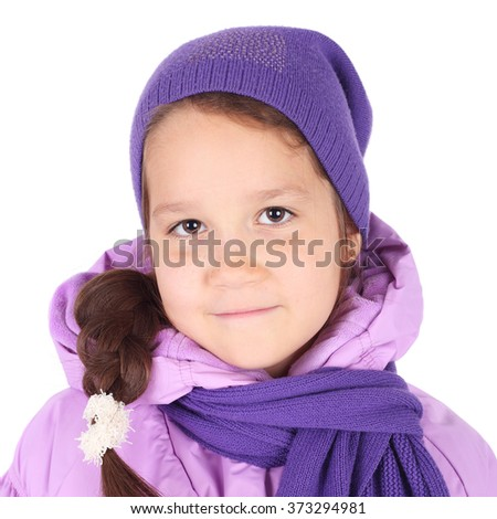 pretty little girl in the winter cap and jacket