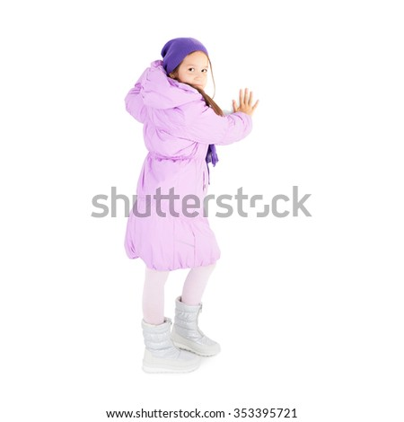 pretty little girl in the winter cap, jacket and boots