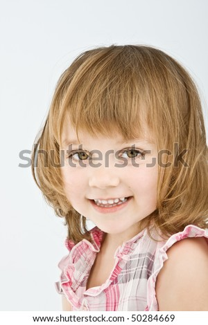 Pretty little girl looking in your eyes isolated on white. - stock photo