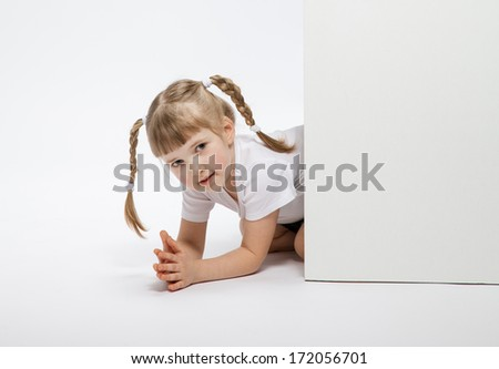 Pretty little girl looking  out of the door, white background - stock photo