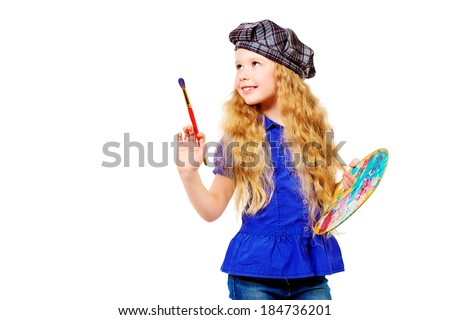 Pretty little girl painter posing with a brush and palette. Isolated over white. - stock photo