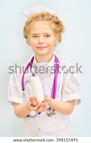 Pretty little girl playing a doctor. Different occupations. Children's Health, Pediatrics. Isolated over white. - stock photo
