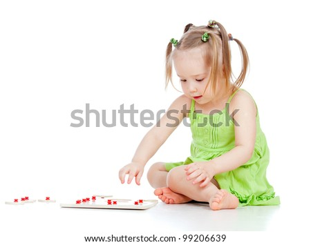 pretty little girl playing with developmental toy - stock photo