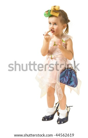 Pretty little girl plays to fashion isolated on white - stock photo