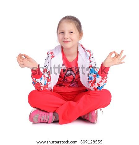 pretty little girl practicing yoga - stock photo