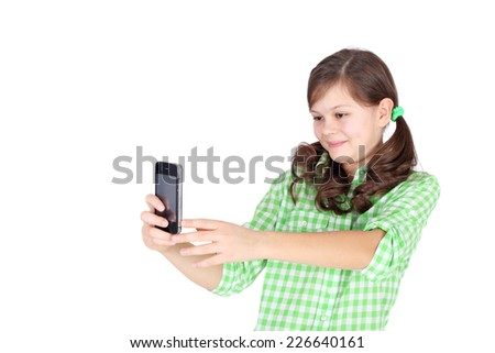 pretty little girl shooting with the mobile phone - stock photo