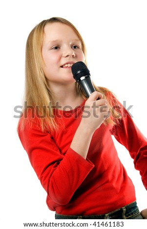 Pretty little girl singing in microphone isolated over white background - stock photo