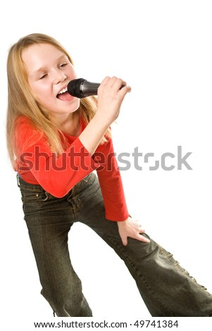 Pretty little girl singing in microphone isolated over white background
