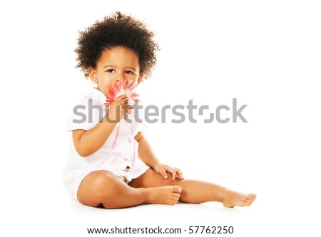 Pretty little girl smelling a flower isolated on white - stock photo