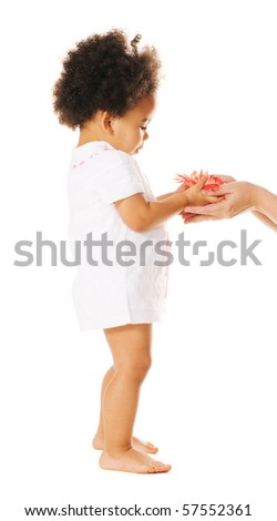Pretty little girl taking a flower from woman's hands - stock photo
